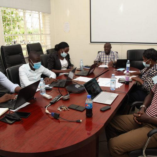 Dr. Revocatus Twinomuhangi (c) flanked by his technical team during the conference